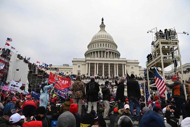 民主不是开峰会喊口号,更不应成为打压别国的政治工具